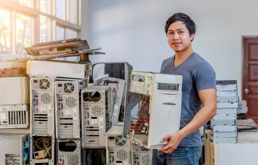 Young man repairing computers